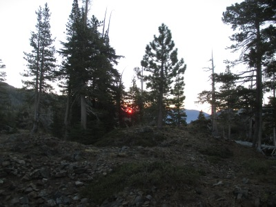 The sun rising in the saddle of the mountains.